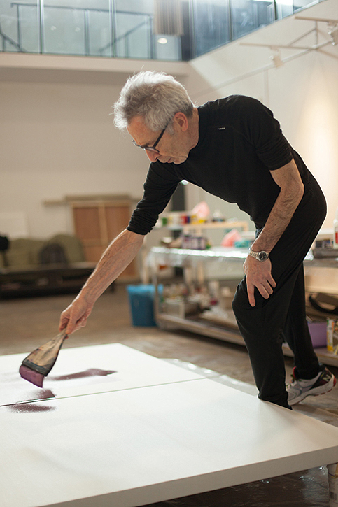 Terry Rose painting in his studio